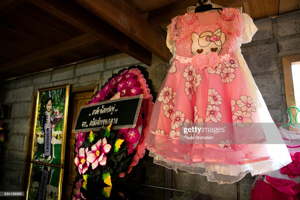 A pink dress is seen next to the coffin of Chomphu, age 8, during a memorial service in the Hmong community of Jom Thong, Chiang Mai province May 25, 2016. A tragic fire broke out on Sunday night killing at least 17 girls at the Pitakkiat Wittaya school, home to pupils from impoverished local hill tribes in the region, they were aged between 5 to 13. Based on reports, many of the 38 students were asleep when the fire swept through the elementary school in Chiang Rai Province and investigations are still being carried out to find the cause of the fire.
