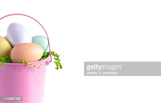 A Pink Easter Basket Filled with Decorated Eggs Isolated on a White Background : Stock Photo