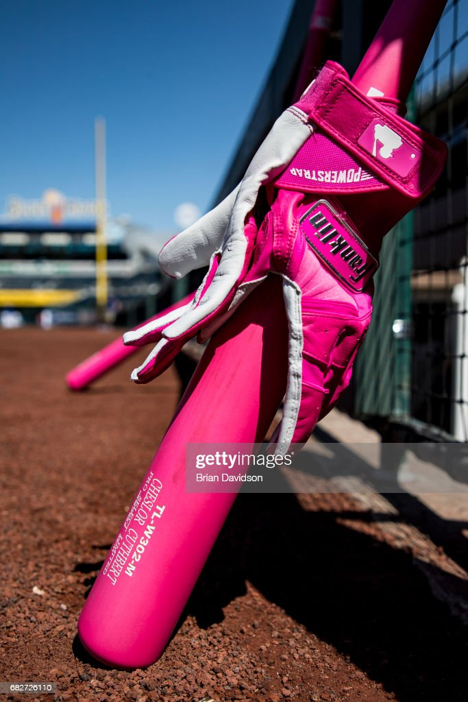 Pink equipment sit outside the Kansas City Royals dugout before the game against the Baltimore Orioles at Kauffman Stadium on May 13, 2017 in Kansas City, Missouri. Players are wearing pink to celebrate Mother's Day weekend and support breast cancer awareness.