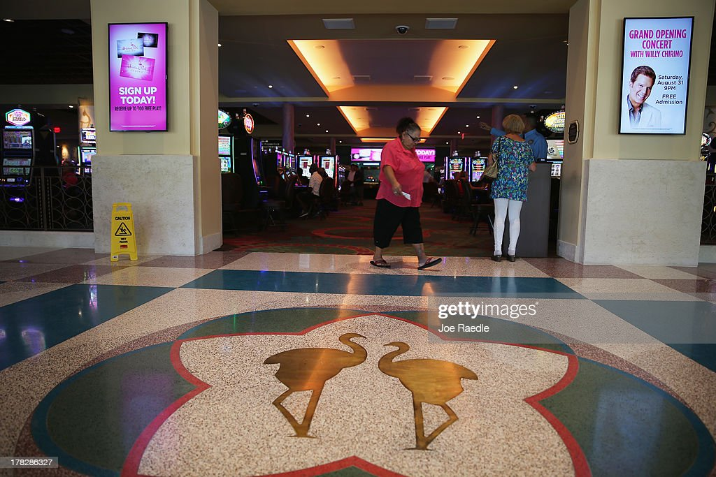 Pink flamingos are seen on the floor at the entranceway to the casino that will hold its grand opening on Friday located in the Hialeah Park Race Track which first opened in 1925 on August 28, 2013 in Hialeah, Florida. The new casino is located in the same complex as the race track which in its heyday was known as the 'the worlds most beautiful race course.'