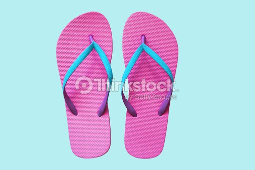 46b19b9470c Pink Flip Flops Isolated On Blue Background Top View Stock Photo ...