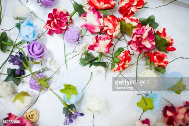Pink flowers on white wooden tables