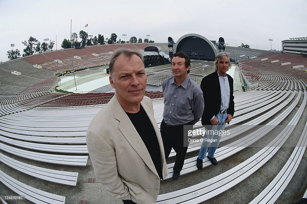 Pink Floyd at the Rose Bowl stadium in Pasadena, California, during the group's Division Bell Tour, 16th-17th April 1994. Left to right: guitarist David Gilmour, drummer Nick Mason and keyboard player Rick Wright.
