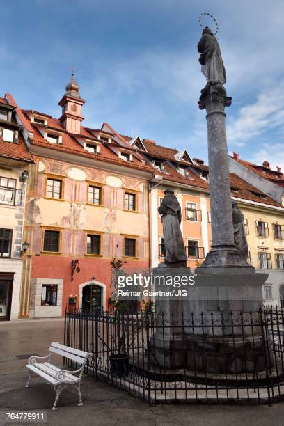Pink frescoes on Old Town Hall building in the Town Square of Skofja Loka Slovenia