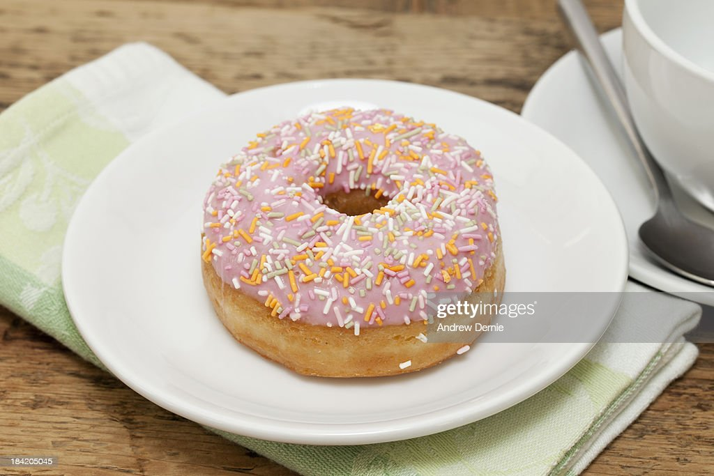 Pink frosted doughnut : Stock Photo