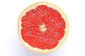 pink grapefruit slice isolated in white