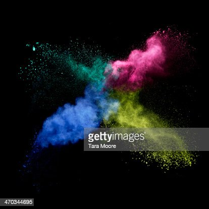 pink, green, blue and yellow smoke colliding