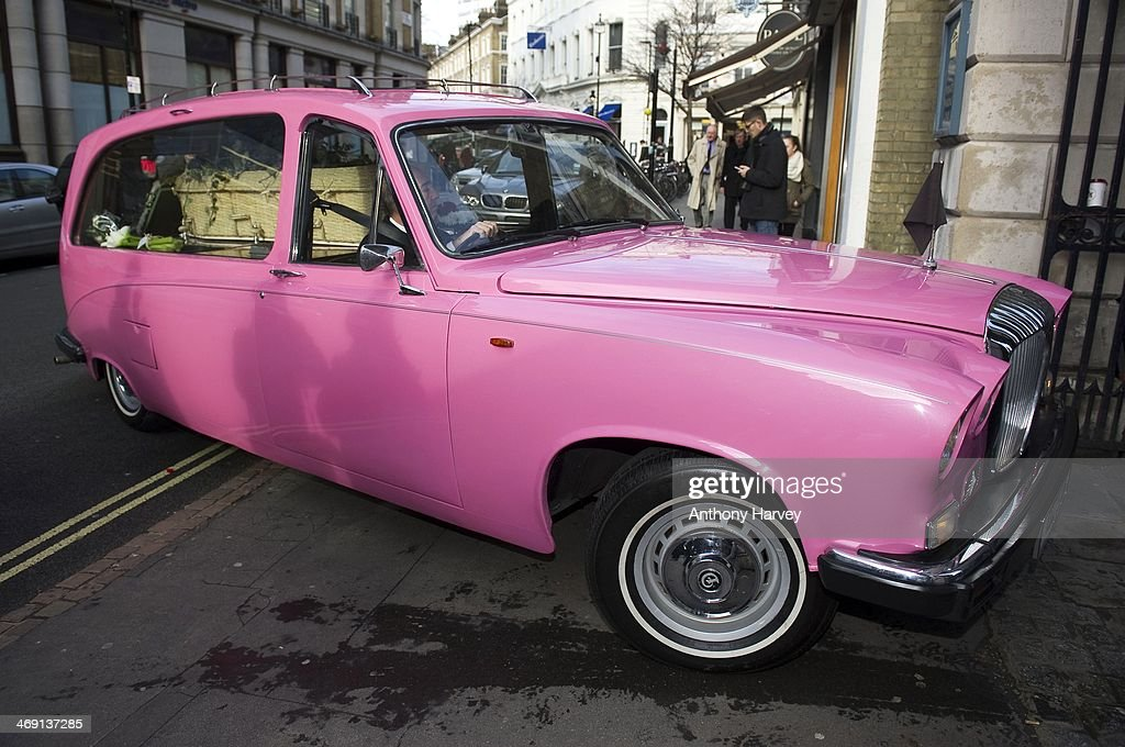 A pink hearse carrying the coffin of actor Roger Lloyd-Pack arrives at St Paul's Church in Covent Garden on February 13, 2014 in London, England.