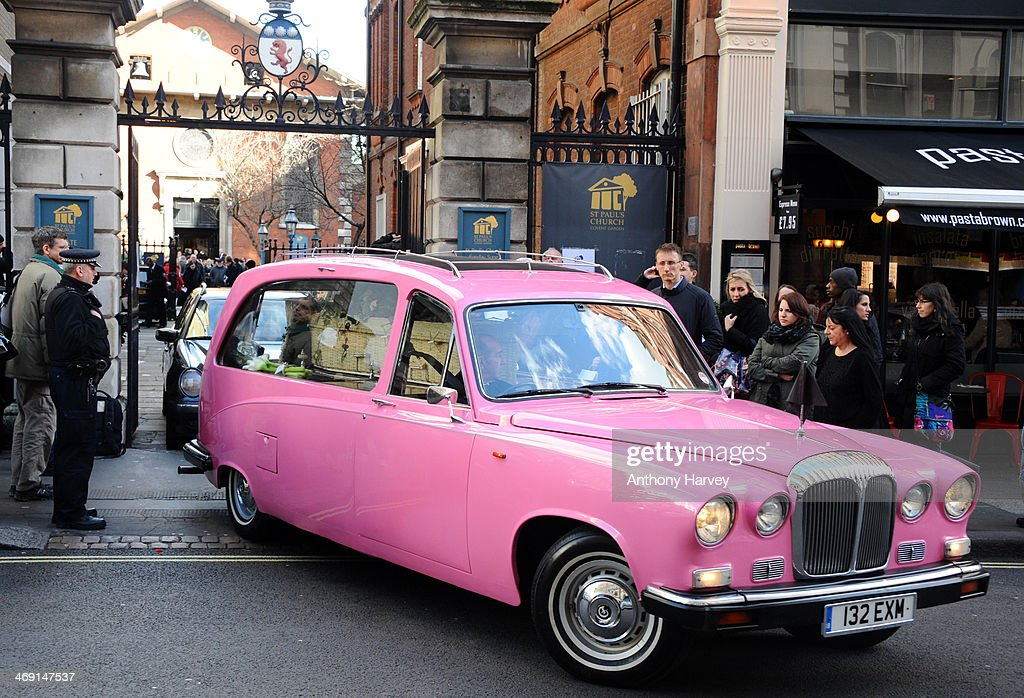 A pink hearse carrying the coffin of actor Roger Lloyd-Pack leaves St Paul's Church in Covent Garden after his funeral service on February 13, 2014 in London, England.