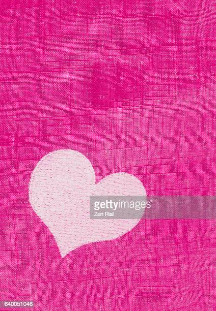A Pink heart embroidered on fabric - Valentines day