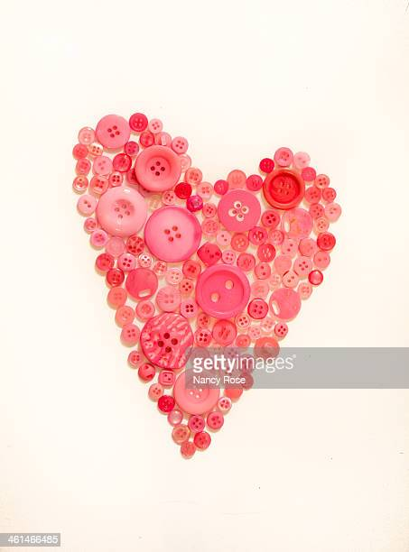 Pink heart made of buttons