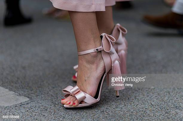 Pink heels with fringes outside Chanel during Paris Fashion Week Haute Couture F/W 2016/2017 on July 5 2016 in Paris France