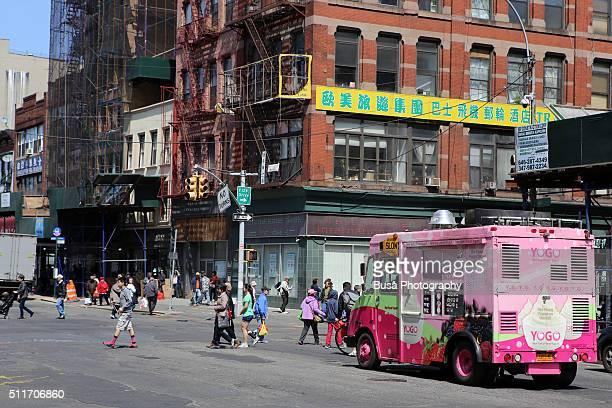 Pink ice cream van in the streets of Chinatown, Manhattan, New York, USA