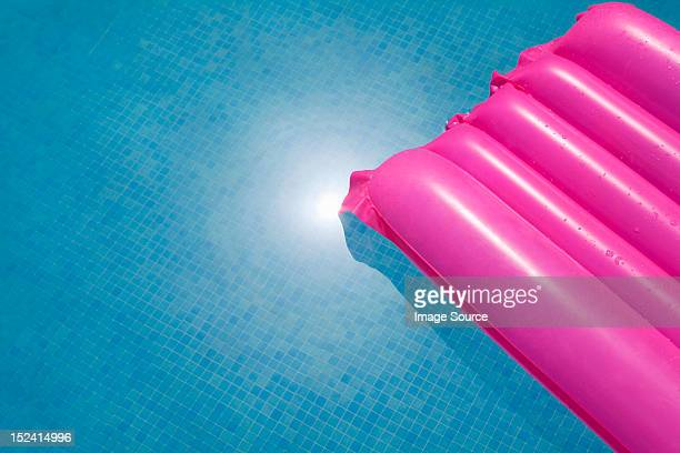 Pink inflatable in swimming pool