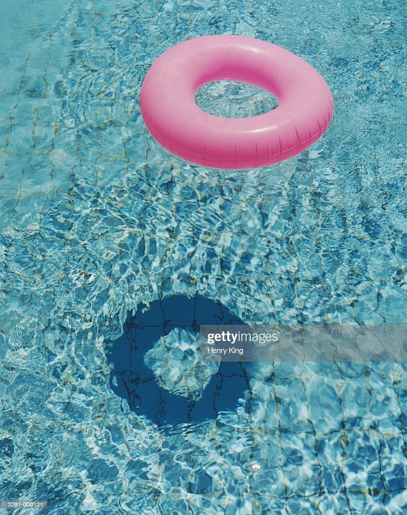Pink Inflatable Ring in Pool