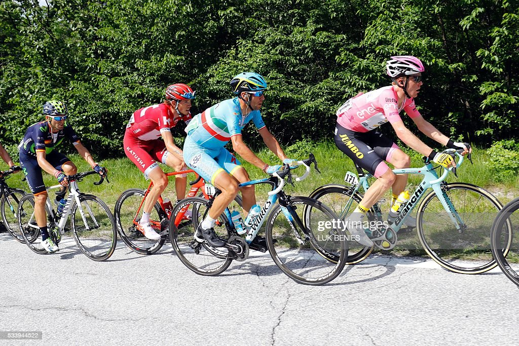 Pink jersey, Dutch Steven Kruijswijk (R) of team Lotto NL rides ahead of Italian cyclist Vincenzo Nibali of Astana Pro team (C), Russia's Ilnur Zakarin of team Katusha, and Spain's Alejandro Valverde (L) of team Movistar during the 16th stage of the 99th Giro d'Italia, Tour of Italy, from Bressanone / Brixen to Andalo on May 24, 2016. Dutchman Steven Kruijswijk moved closer to a history-making Giro d'Italia triumph Tuesday after stretching his lead over Esteban Chaves and Vincenzo Nibali in a thrilling 16th stage won by Alejandro Valverde. / AFP / LUK
