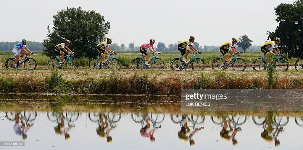Pink jersey (C) Dutch Steven Kruijswijk (Lotto NL) rides with teammates during the 18th stage of the 99th Giro d'Italia, Tour of Italy, from Muggio to Pinerolo on May 26, 2016.