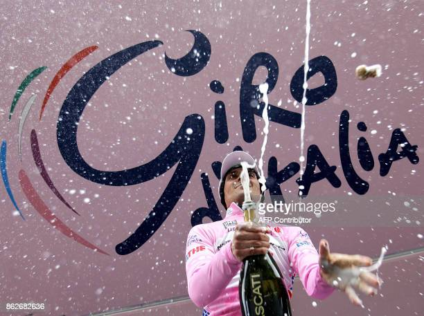 Pink Jersey Italy's Ivan Basso celebrates with champagne his victory of the sixteenth stage of Giro D'Italia cycling tour from Rovato to Monte Bodone...