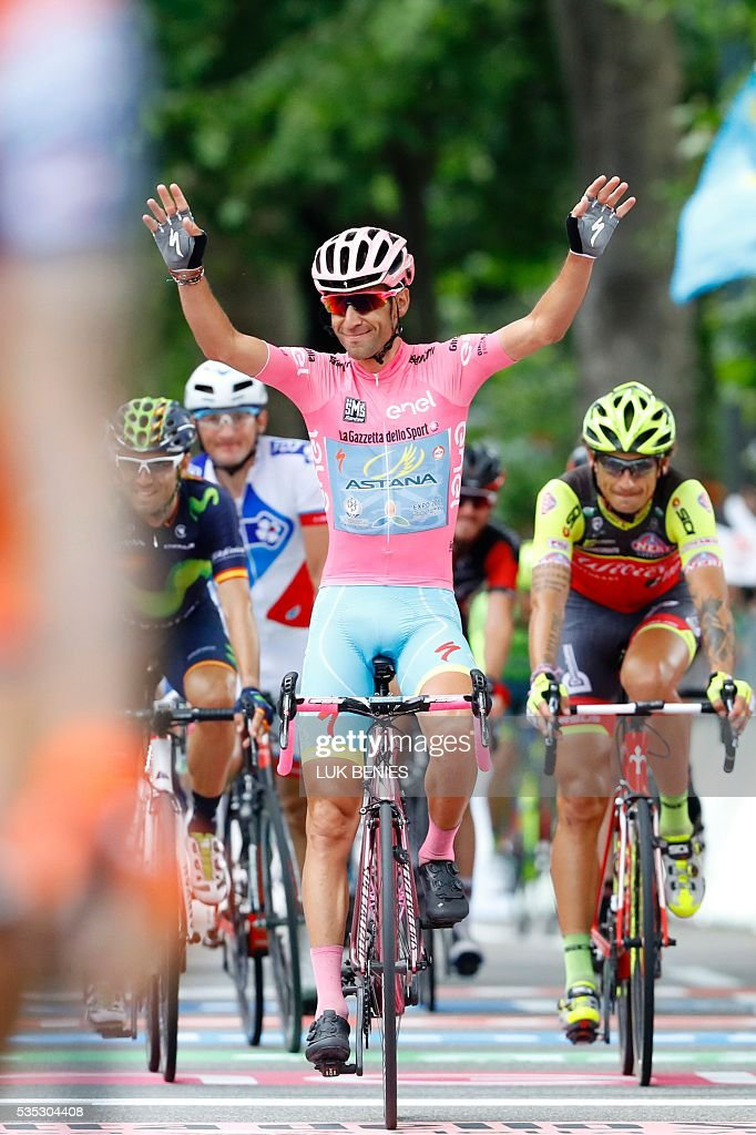 Pink jersey Italy's Vincenzo Nibali celebrates as he crosses the finish line of the 21th and last stage of the 99th Giro d'Italia, Tour of Italy, from Cuneo to Turin on May 29, 2016. Astana's Vincenzo Nibali secured his second Giro d'Italia triumph today after topping a dramatic 99th edition that saw key rival Steven Kruijswijk crash in the final stages of the race. Giacomo Nizzolo, of the Trek team, claimed the final stage honours after outsprinting his rivals in a bunch sprint in Turin. Nibali, who won the race for the first time in 2013, becomes the 69th Italian in 99 editions to win the race for the pink jersey. / AFP / Luk BENIES