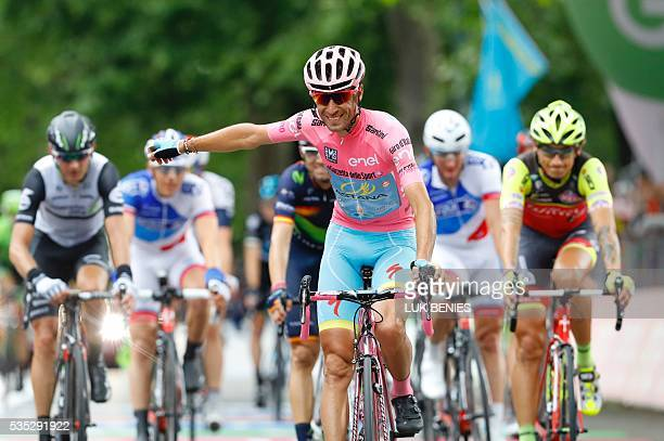 Pink jersey Italy's Vincenzo Nibali crosses the finish line of the 21th and last stage of the 99th Giro d'Italia Tour of Italy from Cuneo to Turin on...