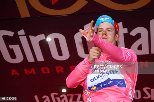 Pink jersey Luxembourg's Bob Jungels of team QuickStep celebrates the pink jersey of the overall leader after the 5th stage of the 100th Giro...