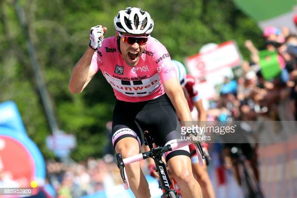 Pink Jersey Netherlands' Tom Dumoulin of team Sunweb celebrates as he crosses the finish line to win the 14th stage of the 100th Giro d'Italia Tour...