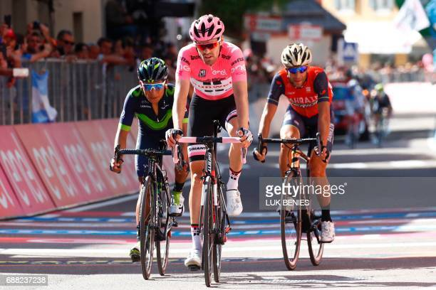 Pink jersey Netherlands' Tom Dumoulin of team Sunweb Colombia's Nairo Quintana of team Movistar and Italy's rider of team Bahrain Merida Vincenzo...