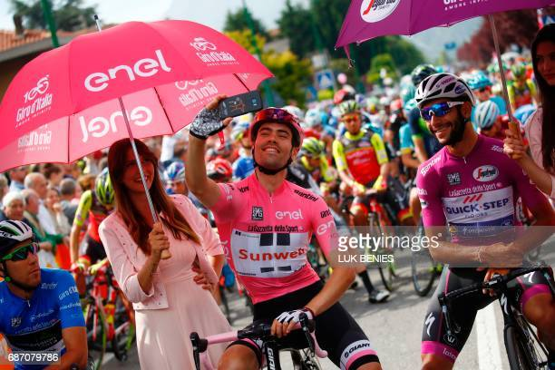TOPSHOT Pink Jersey Tom Dumoulin from Netherlands snaps a selfie next to Cyclamen jersey Colombia's Fernando Gaviria of team QuickStep before the...