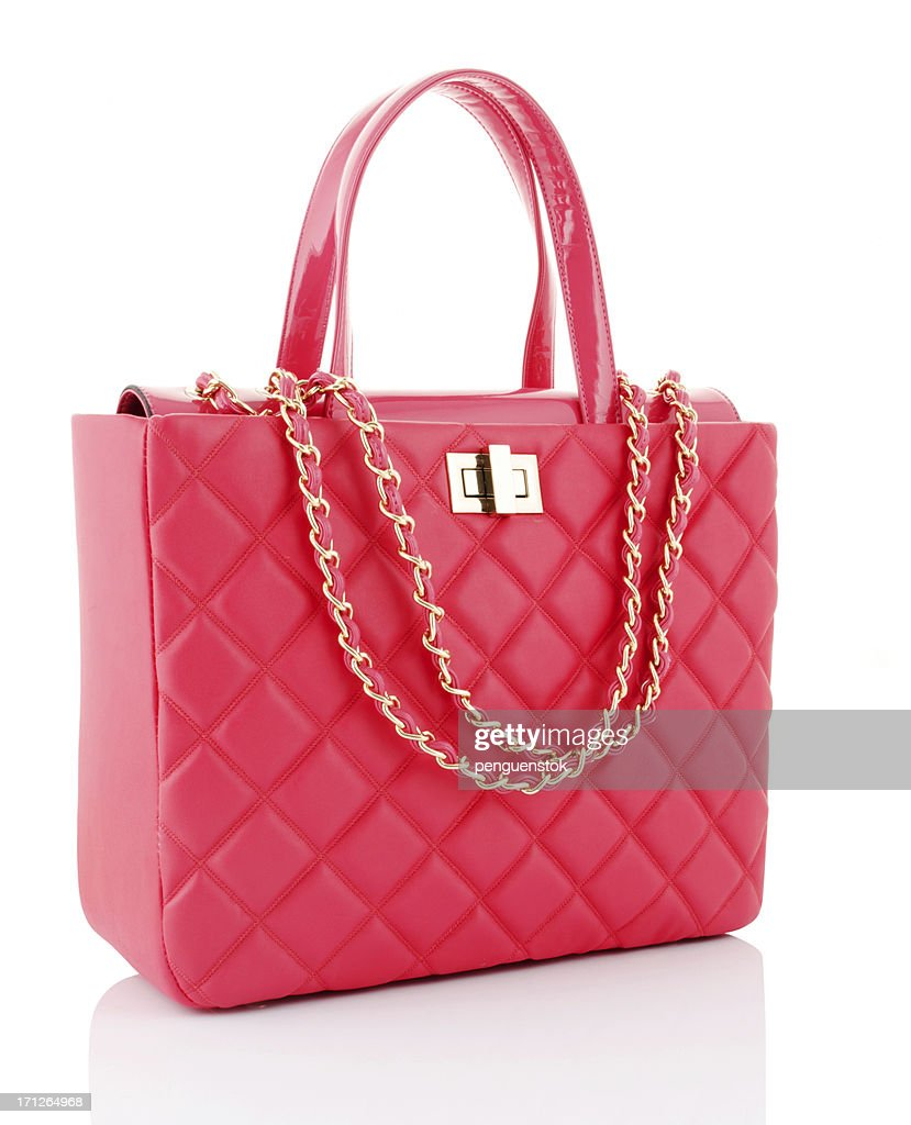 A pink leather bag with gold chains
