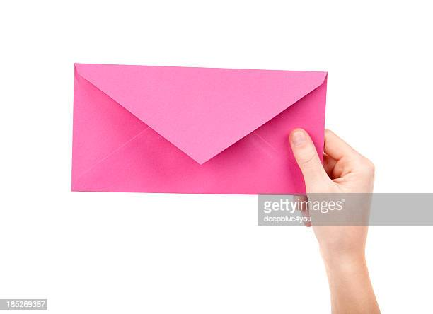 Pink letter in female hand on white