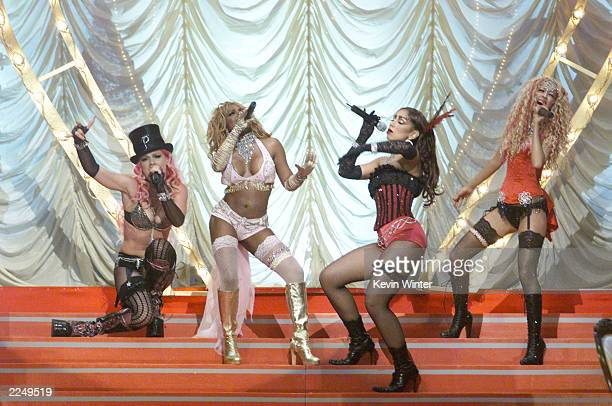 Pink Lil' Kim Mya and Christina Aguilera perform 'Lady Marmalade' from 'Moulin Rouge' at the 2001 MTV Movie Awards at the Shrine Auditorium in Los...
