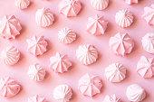 Pink meringues background