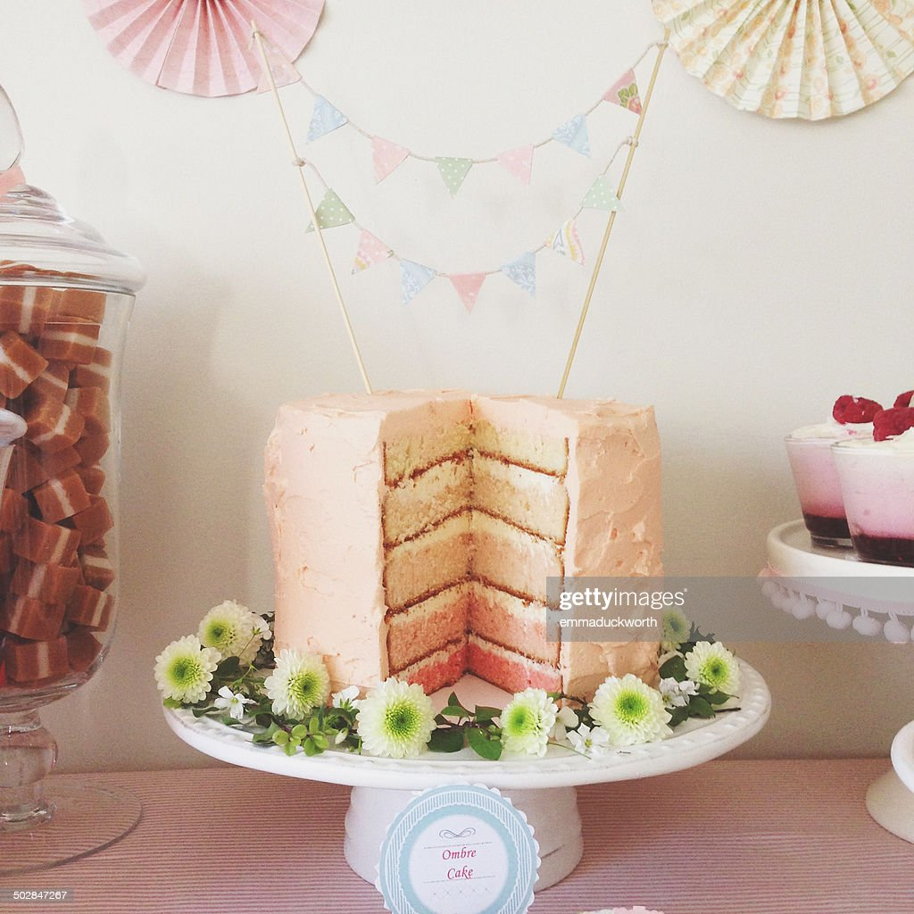 Ombre cake with large slice removed