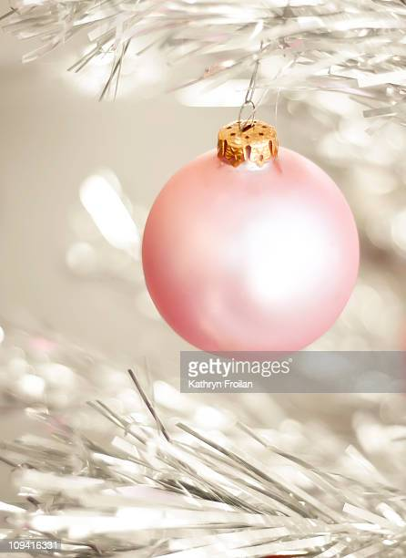 Pink ornament on retro antique aluminum tree