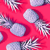 Pink painted pineapples on a magenta background