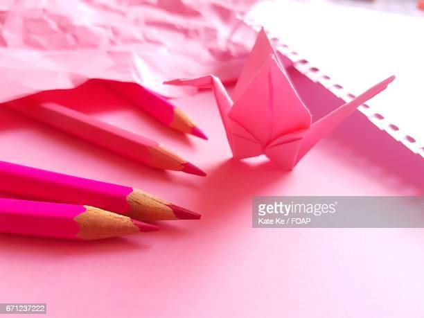 Pink paper crane with colored pencil