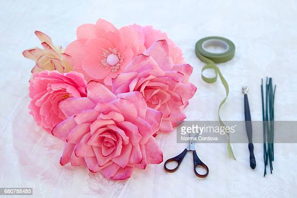 Pink paper roses and florist tools, close-up
