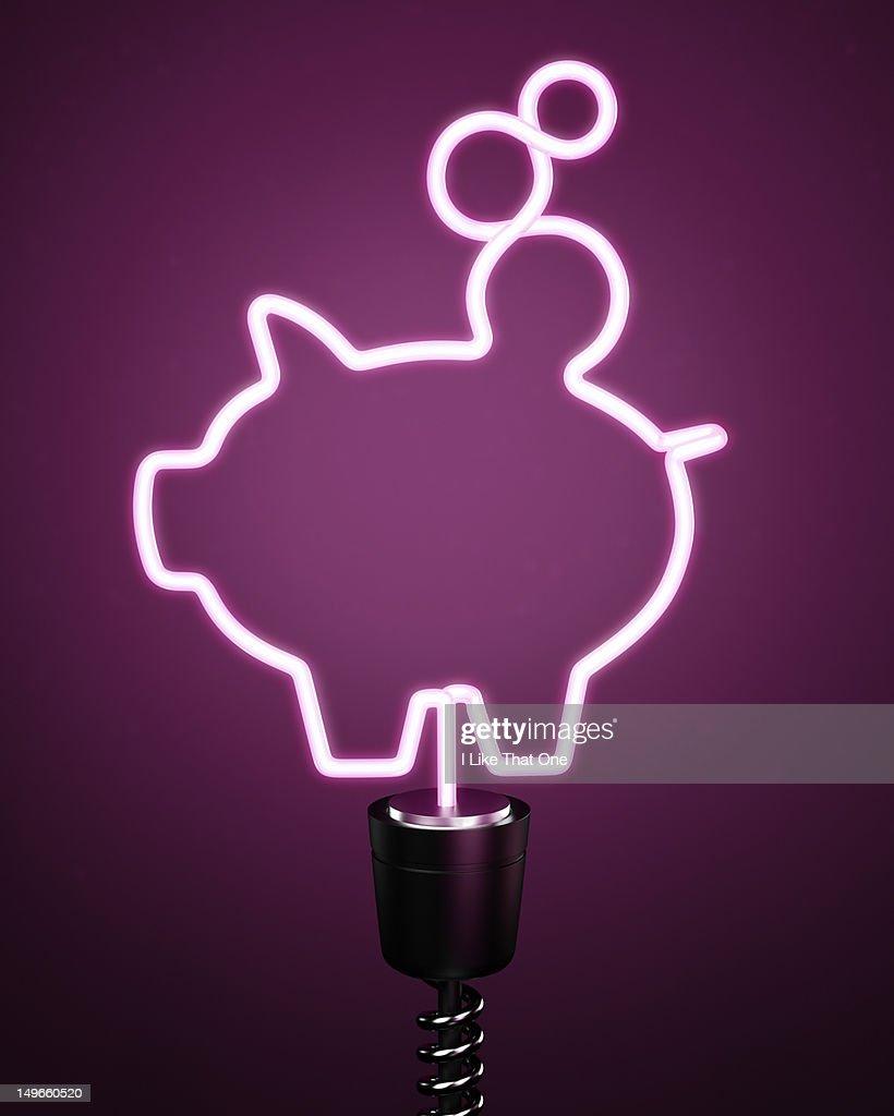 Pink piggy bank energy saving eco lightbulb : Stock Photo