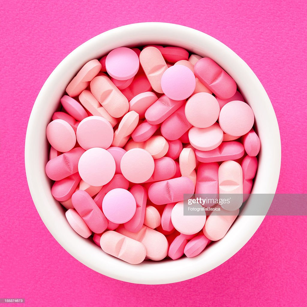 Pink pills : Stock Photo