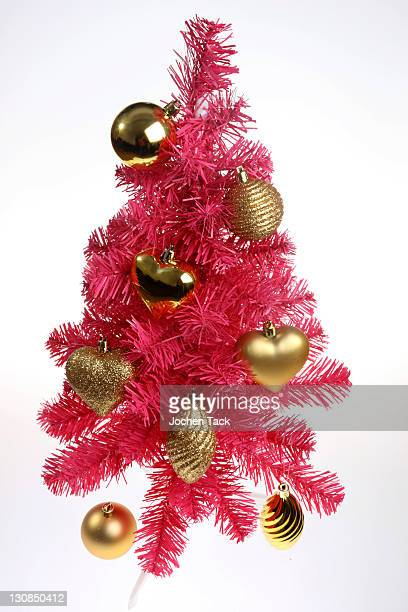 Pink plastic Christmas tree, collapsible, with Christmas decoration