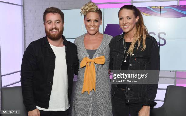 Pink poses with presenters Tom Green and Charlie Tee as she visits the Kiss FM Studios on August 16 2017 in London England