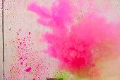 Pink powder paint spraying during Holi festival