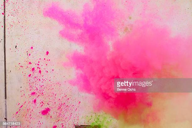 Pink powder paint spraying during Holi festival