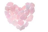 Pink quartz. Heart of rose quartz crystal isolated on white background