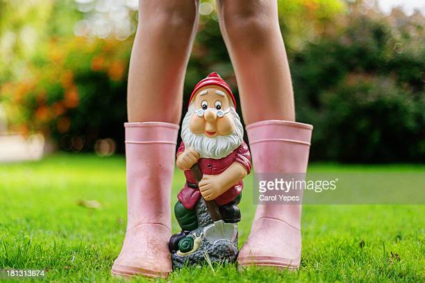 pink rain boots and gnome
