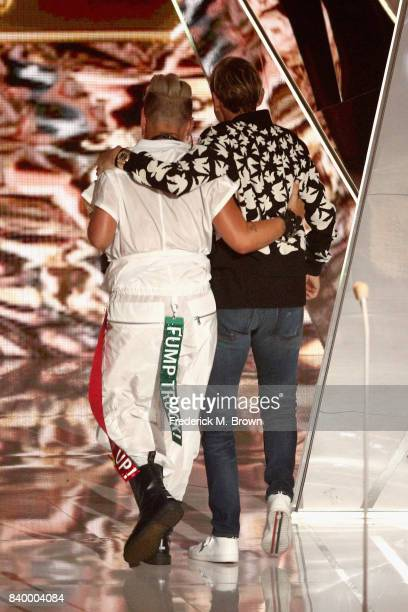 Pink recipient of the Michael Jackson Video Vanguard Award and Ellen DeGeneres walk onstage during the 2017 MTV Video Music Awards at The Forum on...
