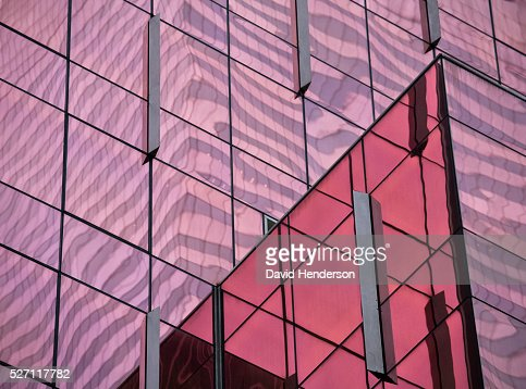 Pink reflections on a glass skyscraper : Stock Photo