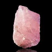 Rose quartz isolated on black background.