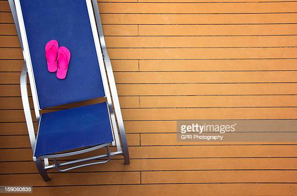 Pink sandals and lounge chair