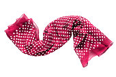 Pink silk scarf with polka dots folded on white background